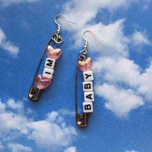 """IM BABY"" safety pin earrings"